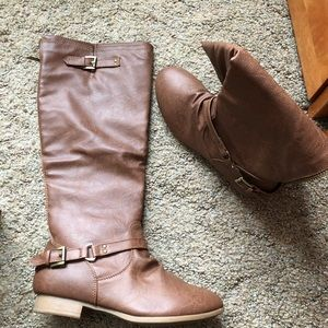 Brown slightly used boots. With back zipper
